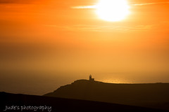 Warm glow this evening (judethedude73) Tags: sunset sky orange sun lighthouse silhouette downs landscape outside photography sussex coast twilight skies sundown dusk silhouettes cliffs coastal belle sevensisters toute