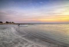 Bright Sunset - Qatar (zai Qtr) Tags: sunset sea sky beach water colors clouds boat sand alone bright outdoor tokina exploration aamir shams gcc qatar advanture ksa exploreqatar zaiqtr