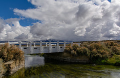 White Wooden Bridge Going Across Hot Creek_ (Basak Prince Photography) Tags: bridge mountains rain clouds landscape bishop strom owensvalley hotcreek easternsierra clearingstorm