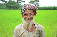 The Cultivator (Ami VONDo) Tags: travel people smile face field smiling rural nikon rice crop farmer bangladesh mehrab saifuzzaman barishal cultivato d5100