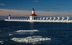 Bright Day on Lake Michigan (Tom Gill.) Tags: winter lighthouse snow ice river pier michigan stjoseph lakemichigan greatlakes driftice rangelights