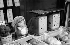 Raccoon in a Greengrocer (Purple Field) Tags: street bw film monochrome japan analog zeiss 35mm walking 50mm store alley kyoto fuji iso400 rangefinder vegetable contax ii carl   neopan ikon  presto  sonnar f20             stphotographia    ii