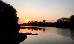 Sunset (Yazed Lord) Tags: sunset sun water river ripples kamshet