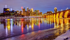 Icy Reflections (Greg Lundgren Photography) Tags: winter urban reflection ice minnesota skyline night river mirror downtown cityscape minneapolis mississippiriver twincities guthrie goldmedalflour stonearchbridge greglundgren onlyinmn