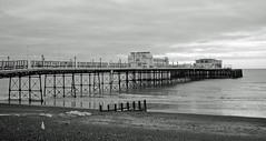 Worthing Pier from the beach (Song-to-the-Siren) Tags: winter blackandwhite 35mm worthing 35mmfilm analogue filmcamera february classiccamera 2016 konicahexaraf ilfordpan100