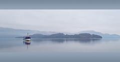 Loch Lomond (Mister Oy) Tags: mist lake reflection water misty reflections landscape island scotland boat loch lochlomond davegreen luss oyphotos fujixt1 fuji1024mm oyphotos