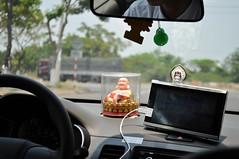 Nodding Buddha (Roving I) Tags: technology buddha religion taxis vietnam figurines gps cabs protection danang nodding satnav beliefs