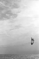 Kitesurf (Federico Pitto) Tags: bw d76 genova hp5 nikonfe2 nikkor50mm18
