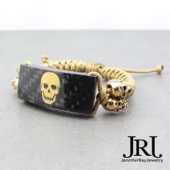 Custom Golden Skulls Carbon Fiber Bracelet. Airbrush by @marshpowerhousefab Carbon by @turbocarbon Skulls by @schmuckatellico Bracelet by @jenniferrayjewelry #jenniferrayjewelry #jrj #jrjcarbon #carbonfiber #carbonfibre #goldskull #edc #usntagram #wristsh (JenniferRay.com) Tags: ray jennifer jewelry carbon custom fiber exclusive paracord jrj instagram