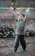 Boy and the bubbles (FotoGrazio) Tags: boy portrait people art smile composition fun photography kid child photoshoot joy streetphotography happiness bubbles fantasy portraiture imagination moment photographicart capture bubbleboy digitalphotography selectivecolor sandiegophotographer artofphotography flickrelite californiaphotographer internationalphotographers worldphotographer photographersinsandiego fotograzio photographersincalifornia waynegrazio waynesgrazio