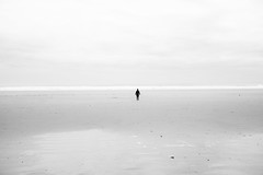 Into the unknown (Rangarajan Ramesh) Tags: ocean uk sea white black cold beach nature water beautiful silhouette wales clouds walking person one scary sand perfect alone britain stones horizon windy minimal single stunning simple stroll