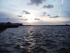 New Brighton Dusk (Lydie's) Tags: sky water clouds dusk atmosphere chemtrails wallasey marinelake newbrighton