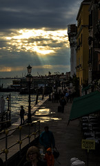 Heaven's Sun Rays (Venice) (filippogatteschi) Tags: life street venice sunset people sun art tourism nature colors beauty clouds contrast canon reflections island eos evening calle seaside high day shadows time cloudy vivid lagoon highlights tourists late 24 rays laguna everyday tamron 70 venezia moorings lowlights simmetry darks 70d ormeggi