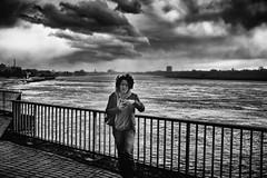 Storm (Braiu) Tags: street city urban bw storm river germany de wind candid streetphotography dusseldorf dsseldorf rhine nordrheinwestfalen candidportrait