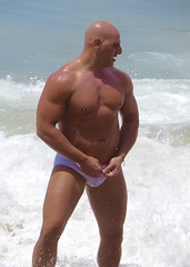 IMG_1176 (danimaniacs) Tags: shirtless man hot sexy guy beach smile pecs muscle muscular beefy bald trunks speedo swimsuit stud mansolo