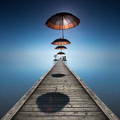 Umbrellas (Pedro Daz Molins) Tags: blue lake color art azul umbrella pie lago nikon pedro paraguas fie diaz d800 molins pantalan paragua fieart piterart