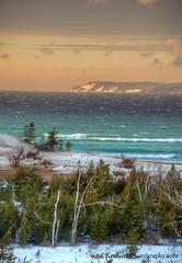 Lake Michigan ... Island glimpse (Ken Scott) Tags: winter sunset usa snow michigan january blow lakemichigan greatlakes breaker freshwater voted southmanitouisland leelanau 2016 45thparallel backpage fhdr sleepingbearpoint sbdnl sleepingbeardunenationallakeshore mostbeautifulplaceinamerica
