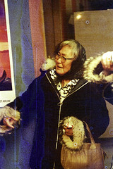 30-479 (ndpa / s. lundeen, archivist) Tags: wien winter people woman color fall film 30 alaska scarf 35mm poster glasses coast town airport waiting locals village native room coat nick terminal spots coastal purse oldwoman local passenger nome 1970s eyeglasses damaged 1972 distressed handbag waitingroom parka alaskan dewolf natives nativealaskan discolored heatdamage damagednegative furlined nickdewolf photographbynickdewolf coastalvillage wienconsolidatedairlines reel30 wienconsolidated