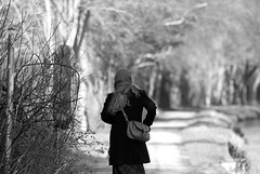 untitled (robwiddowson) Tags: people blackandwhite woman nature scarf hair walking photography photo path picture photograph humans