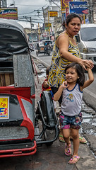 Hold on to mommy (FotoGrazio) Tags: family people woman girl kid child tricycle philippines daughter mother streetphotography streetportrait streetscene bulacan filipina hold bonding socialdocumentary motheranddaughter babae travelphotography pacificislanders documentaryphotography baliuag batangbabae fotograzio waynegrazio