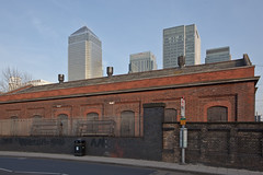 Warehouse and towers (Gary Kinsman) Tags: urban london tower architecture modern contrast skyscraper cityscape empty victorian warehouse highrise docklands canarywharf desolate plain mundane e14 urbanlandscape redbrick millwall onecanadasquare isleofdogs jpmorgan canon1740mmf4l topographics 2013 westferryroad citigrouptower newtopographics hydraulicpumpingstation canoneos5dmarkii canon5dmkii