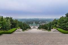Revolutionary Martyrs Cemetery (reubenteo) Tags: sunset building sunrise landscape asia korea communist communism kimjongil socialist socialism northkorea pyongyang kimilsung kimjongun