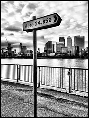 Here (firstnameunknown) Tags: camera city sculpture london art monochrome thames skyline river blackwhite cityscape greenwich signpost publicart canarywharf peninsula northgreenwich theline thomsoncraighead iphoneography