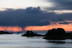 After the sun disappears below the horizon (rjonsen) Tags: sunset cloud rain dark island shower haugesund