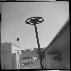 Trailer flower. (helioshamash) Tags: urban bw 6 white black 6x6 train square los angeles kodak tmax 150 medium format 100 grime rodinal kiev tmx