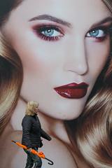 Umbrella @ Amsterdam (Rokin) (PaulHoo) Tags: street city urban woman amsterdam umbrella lumix candid streetphotography advertisement 2016 rokin streetcandid