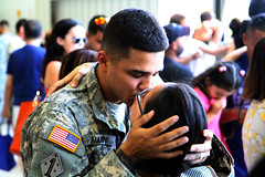 A deploying Soldier kisses a loved one as he prepares to depart on a 12-month mission to Africa in support of Operation Freedom's Sentinel. The farewells were shared by thousands during a deployment ceremony, April 10, at a hangar in Fort Lauderdale, Fla. (US Army Africa) Tags: italy hoa vicenza mdf hornofafrica djibouti mgwilliams sa16 royalnetherlandsarmy africom casermaederle usafricacommand floridaarmynationalguard usarmyafrica usaraf usafricom camplemonnier armyafrica malawidefenceforce 75thtrainingcommand majgendarrylawilliams africanhorizons briggenjonajensen malawisouthernafricandevelopmentcommunity southernaccord2016