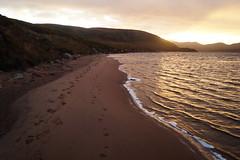 Footprints (christianbartlett) Tags: light sky lake beach water sunrise walking landscape outdoors coast scotland countryside lowlight sand scenery waves outdoor lakes shore loch landschaft farnorth lochs schottland capewrath scottishhighlands sandwood sandwoodbay
