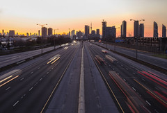 Rise and Shine (...Iwonttell) Tags: longexposure toronto skyline sunrise highway cityscape colours lighttrails colourful
