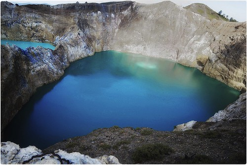 Mount Kelimutu with three coloured crater lakes.
