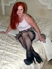 Sarah_4121 (Fast an' Bulbous) Tags: england woman hot sexy stockings girl hair print yummy high bed bedroom nikon long flash gimp indoor skirt babe chick redhead mature leopard boudoir heels mummy milf stilettos d7011