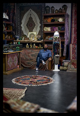 Asian Shopkeeper (FimRay) Tags: people shop asian persian interior rugs carpets mats shopkeeper brickabrac