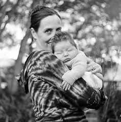 Hugs (Timothy Lewis Jr.) Tags: blackandwhite bw children outdoors trix mother yashica yashicad blackandwhitefilm naturallightportrait