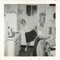 Kitchen Dance, 1958 (STUDIOZ7) Tags: woman kitchen girl fifties cigarette snapshot suburbia skirt smoking teen 1950s teenager 50s smoker teenage