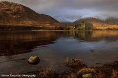 Kilchurn Castle Scotland. (stavros karamanis Photography) Tags: old sunset lake snow mountains castle water canon landscape scotland afternoon ngc tokina mountainside dslr f28 t3i lakescapes kilchurncastle canonphotography 1116mm dxii