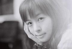 Charlotte (Jon Siegel) Tags: portrait blackandwhite bw woman film girl beautiful smile hongkong iso3200 50mm evening nikon thoughtful thinking 12 nikkor ilford 50mm12 nikonfe2 nikon50mmf12ais