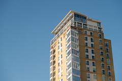 Westwards (photosam) Tags: england london architecture 50mm raw unitedkingdom telephoto highrise housing fujifilm docklands modernist lightroom towerhamlets xe1 fujifilmx xc50230mmf4567ois xc50230mm14567ois