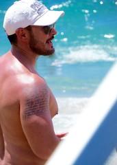 IMG_1211 (danimaniacs) Tags: shirtless man hot sexy guy beach pecs hat tattoo beard cap stud scruff mansolo