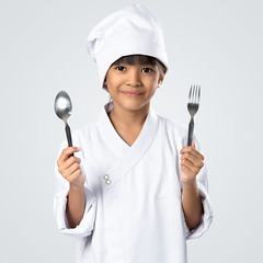 Happy little chef holding a spoon and fork (Patrick Foto ;)) Tags: portrait people food woman white playing cute utensils cooking kitchen girl beautiful beauty smile wearing hat childhood breakfast asian happy grey kid holding education pretty alone child hand emotion little eating background small daughter young cook adorable sausage posing fork tools apron chef attractive concept showing housewife isolated advertise greyhappy