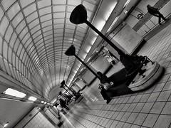 Take A Pew (Douguerreotype) Tags: city uk england people urban blackandwhite bw london monochrome bench underground subway lights mono metro britain tube gb british