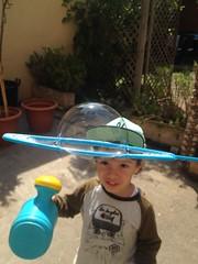 BubbleKid (maikrofunky) Tags: boy beautiful kid dad son patio bubble gorra guapo padre niño burbuja hijo macetas iphone dady baseballcup iphone4s béisbolcup