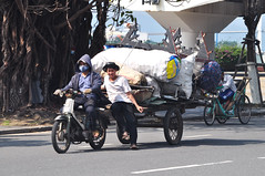 On the move (Roving I) Tags: street friends workers vietnam carts loads danang logistics hoodies motorscooters facemasks