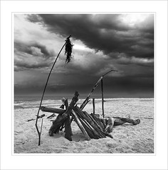 Stick Boat B&W frame (caralan393) Tags: sky sculpture storm beach clouds square sticks sand frame
