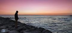 L'uomo e il mare (Luca Romano) Tags: sea panorama colors silhouette landscape colorful tramonto mare waves outdoor pace colori panoramico serenit seasunset seasunclouds coloribellissimi