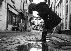 puddle moon (matthewheptinstall) Tags: uk winter england holiday reflection girl rain lakes lakedistrict splash cobbledstreet jumpingintopuddles