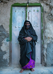 an old bandari woman wearing a traditional mask called the burqa, Qeshm Island, Salakh, Iran (Eric Lafforgue) Tags: door people woman vertical outdoors photography clothing asia veil mask iran muslim islam traditional religion hijab indigo persia hidden identity human elderly covered iranian adults adultsonly oneperson islamic burqa ethnicity frontview persiangulf sunni elderlywoman qeshmisland chador hormozgan onewomanonly lookingatcamera burqua handscrossed  bandari  blackveil 1people  iro straitofhormuz  colourpicture  salakh borqe boregheh irandsc04596